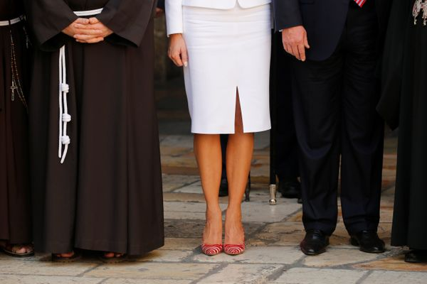 Melania and Donald Trump stand next to members of the Christian clergy during their visit to the Church of the Holy Sepu