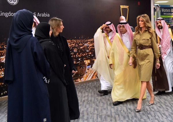 Melania Trump walks alongside Saudi Commerce and Investment Minister Majed al-Qasabi (center), as she visits the GE All-Women