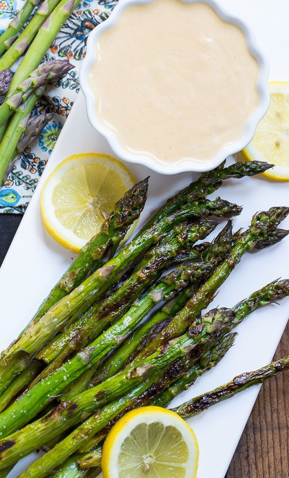 "<strong>Get the <a href=""http://spicysouthernkitchen.com/grilled-asparagus-with-wasabi-soy-dipping-sauce/"" target=""_blank"">Gr"