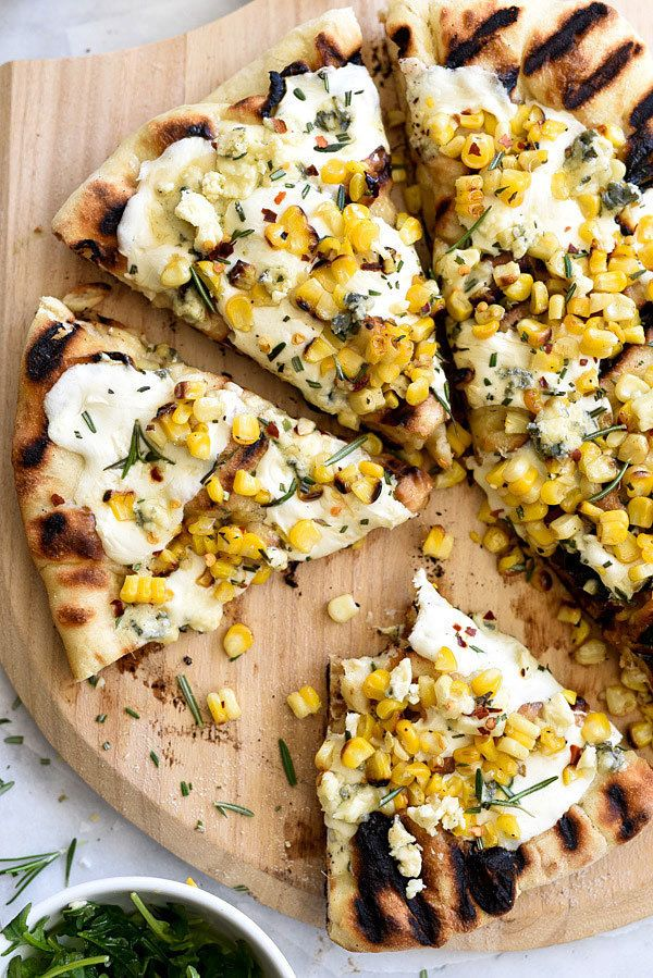 "<strong>Get the <a href=""http://www.foodiecrush.com/2015/05/charred-corn-and-rosemary-grilled-pizza/"" target=""_blank"">Charred"