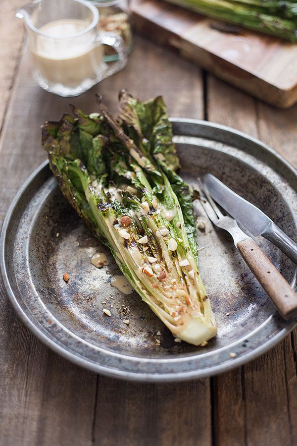 "<strong>Get the <a href=""http://slimpalate.com/grilled-romaine-with-toasted-almonds-and-caesar-dressing/"" target=""_blank"">Gri"
