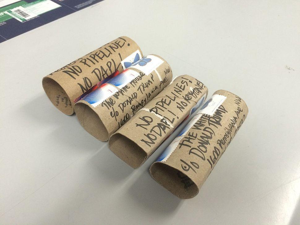 """Donny Miller, """"No DAPL Toilet Paper Rolls."""" Cardboard toilet paper rolls."""