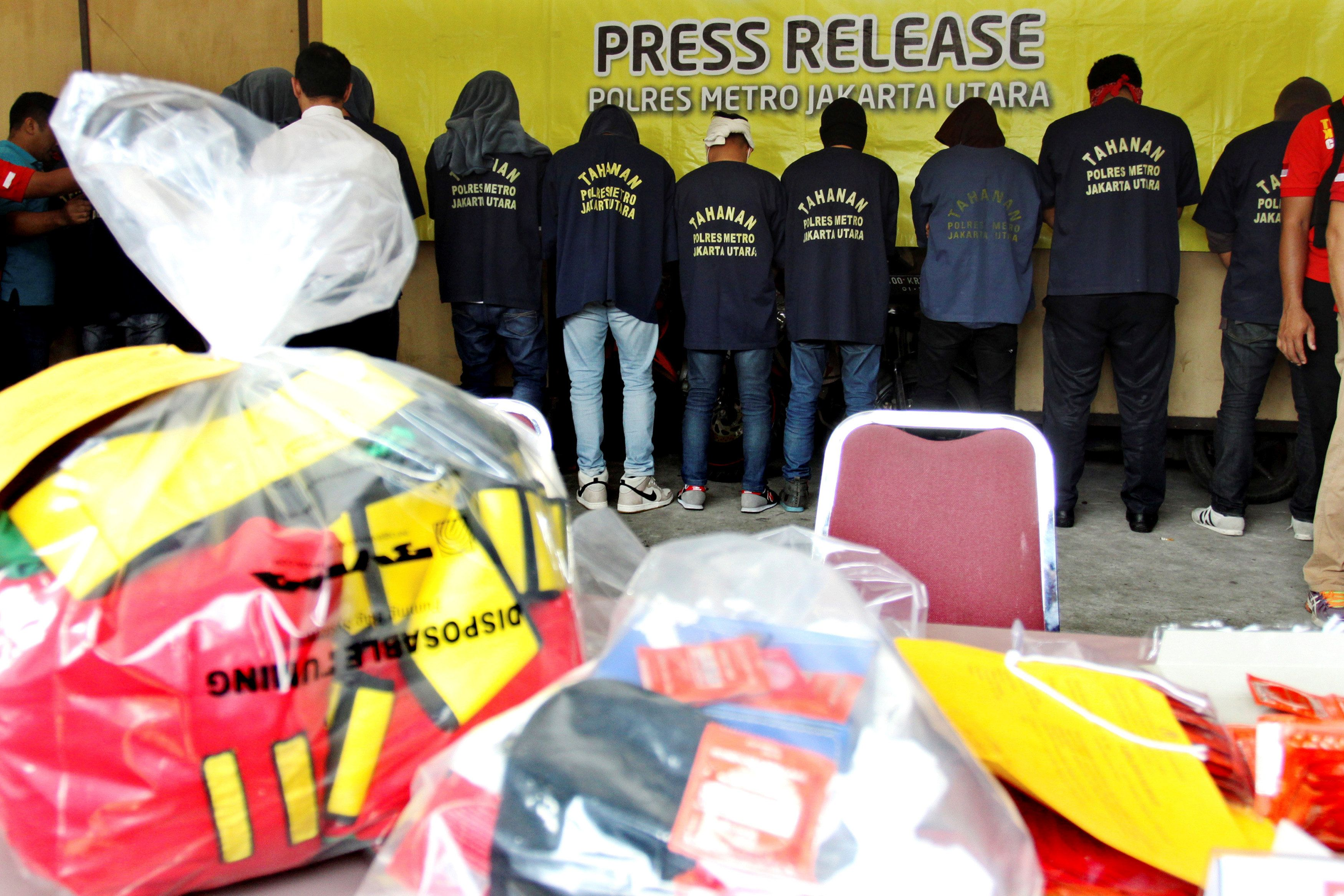 Some of the more than 140 men detained after a raid on what authorities described as a gay prostitution ring being run out of an entertainment venue are shown to the media at a police station in Jakarta, Indonesia May 22, 2017 in this photo taken by Antara Foto. Antara Foto/Reno Esnir via REUTERS    ATTENTION EDITORS - THIS IMAGE HAS BEEN SUPPLIED BY A THIRD PARTY. EDITORIAL USE ONLY. MANDATORY CREDIT. INDONESIA OUT. NO COMMERCIAL OR EDITORIAL SALES IN INDONESIA.