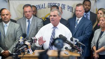 BALTIMORE, MD  - JULY 27:   Baltimore Fraternal Order of Police president Gene Ryan (C) holds a press conference with the officers and their attorneys involved in the Freddie Gray case in Baltimore, MD on July 27, 2016.   Earlier today, prosecutors dropped all charges against the three officers Garrett Miller, Alicia White and William Porter who were awaiting trial in the Freddie Gray case.  In effect, it has closed the books on the high-profile case which originally caused rioting in the streets of Baltimore last year.  Not one of the officers was convicted.  (Photo by Linda Davidson / The Washington Post via Getty Images)