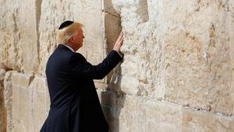 U.S. President Donald Trump touches the Western Wall, Judaism's holiest prayer site, in Jerusalem's Old City May 22, 2017. REUTERS/Ronen Zvulun
