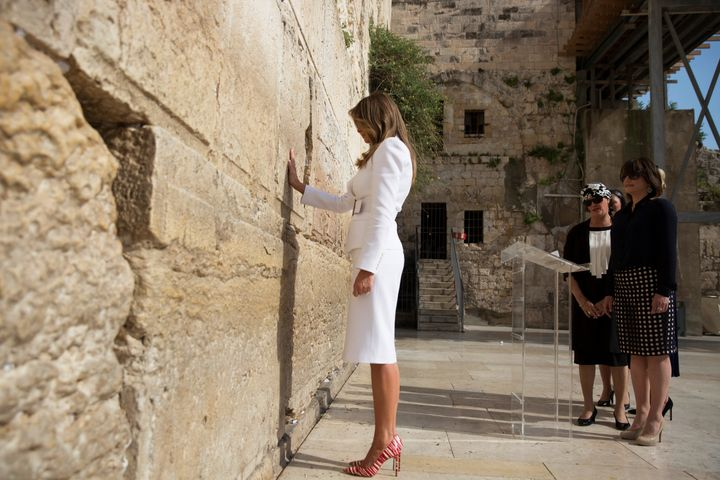 U.S. first lady Melania Trump prays as she touches the Western Wall, Judaism's holiest prayer site, in Jerusalem's Old City M