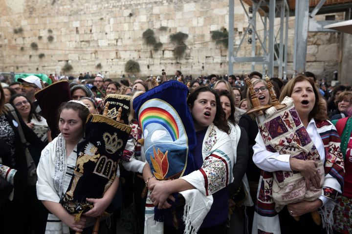 Israeli members of the liberal Jewish religious group Women of the Wall, carry a Torah scroll after prayers in the women's se