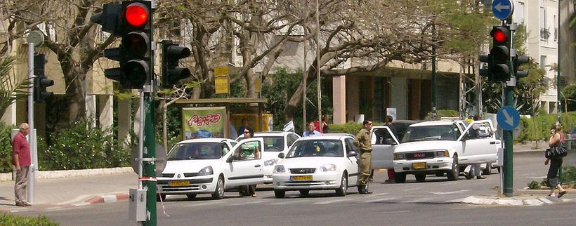 Drivers in Tel Aviv stand at attention beside their cars during the siren