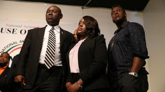 Tiffany Crutcher (C), sister of Terence Crutcher, the Tulsa motorist who was shot and killed by police, stands with attorney Benjamin Crump (L) during a news conference at the Reverend Al Sharpton's National Action Network headquarters in New York, U.S., September 21, 2016.  REUTERS/Shannon Stapleton