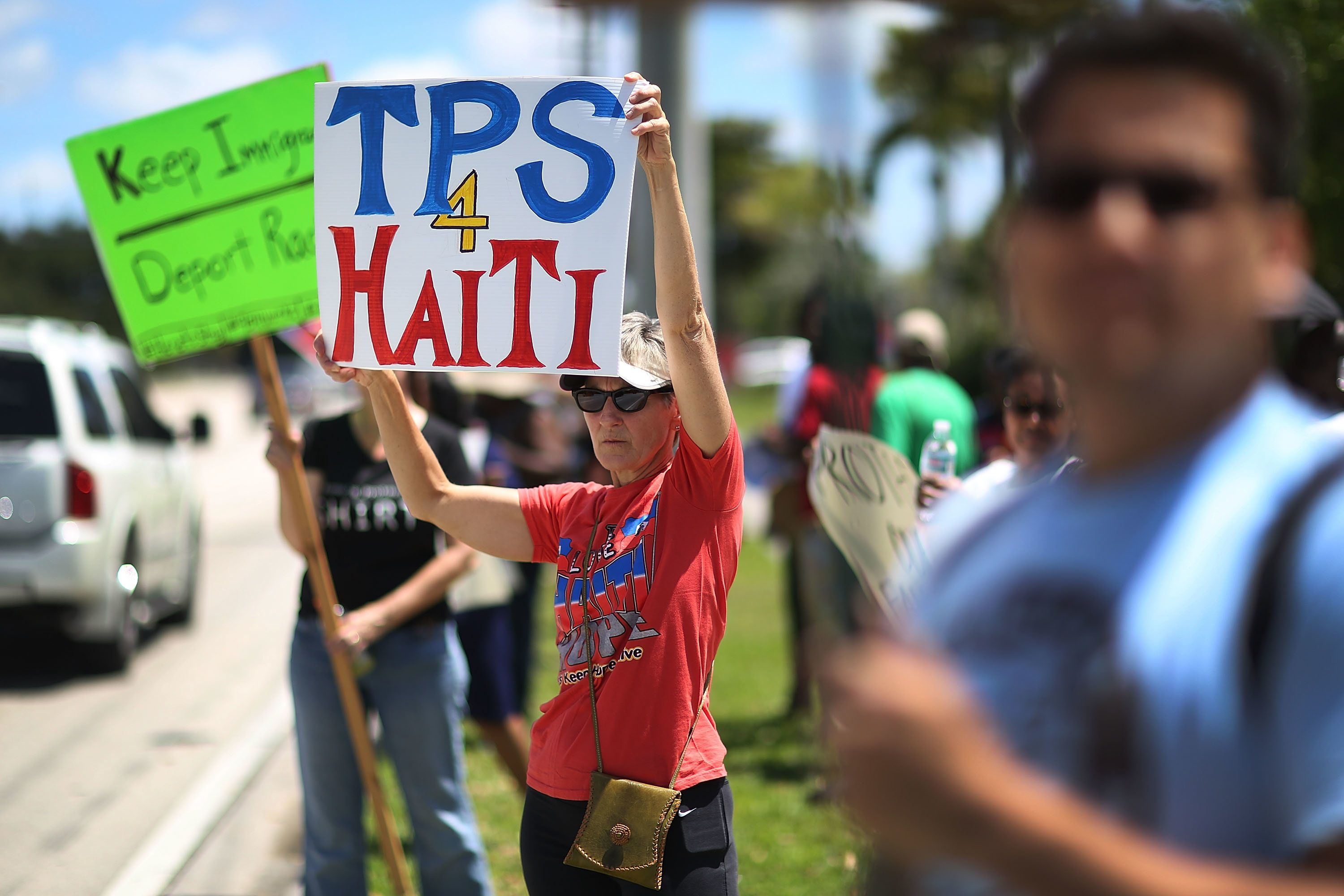 Protesters gather in front of the U.S. Citizenship and Immigration Services office in Broward County, Florida, on May 21 to u