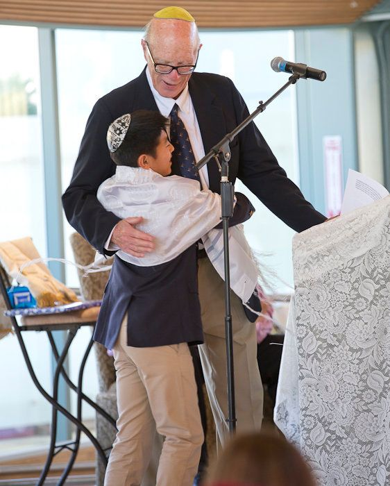 The author's late husband with their son becoming a Bar Mitzvah in 2014.He is missed in the smallest of ways, including