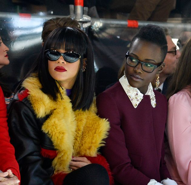 Rihanna and Lupita Nyong'o attend the Miu Miu show during Paris Fashion Week on March 5,