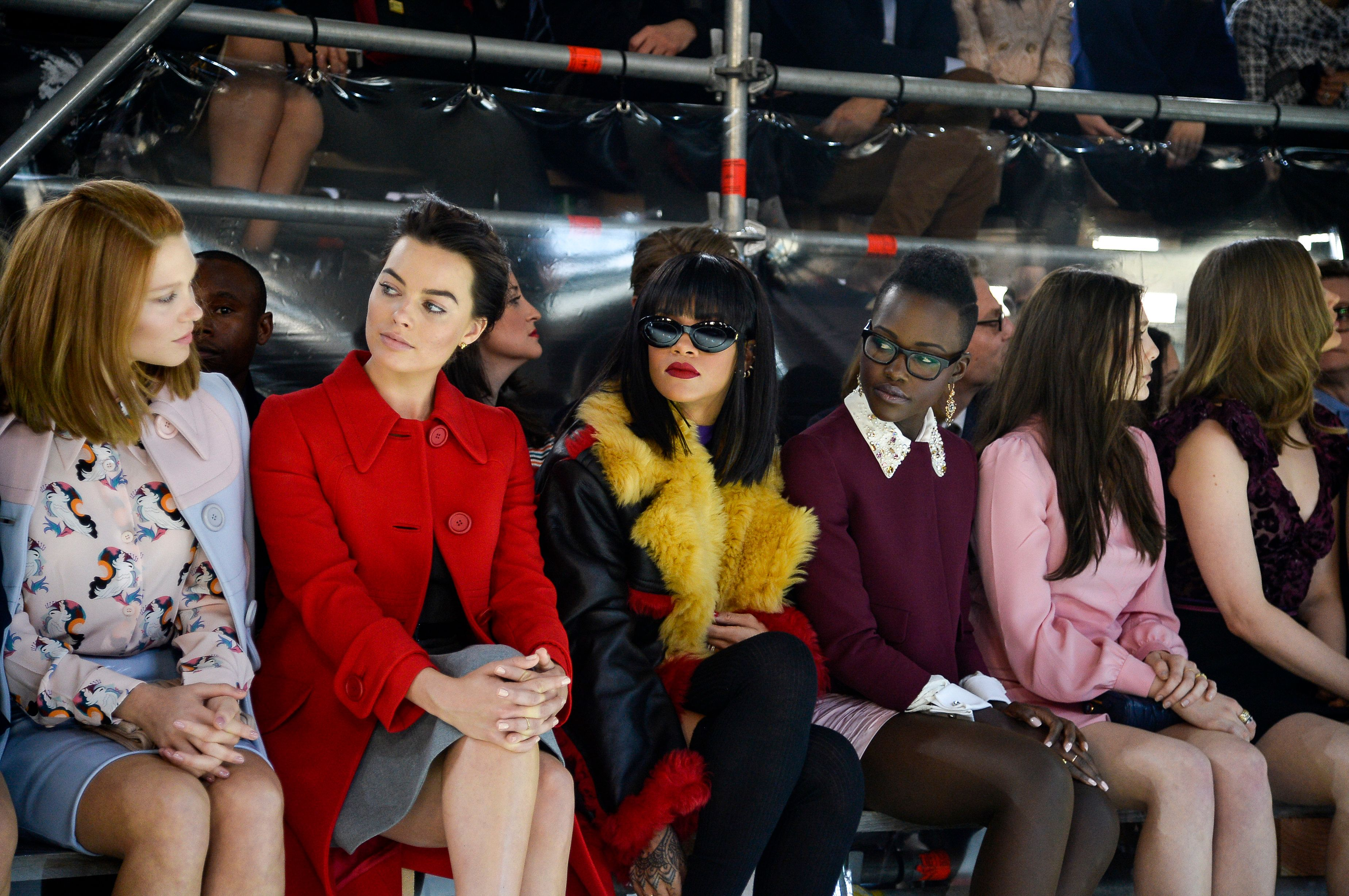 PARIS, FRANCE - MARCH 05:  (L-R) Actress Lea Seydoux, Margot Robbie, singer Rihanna, actresses Lupita Nyong'o and Elizabeth Olsen attend the Miu Miu show as part of the Paris Fashion Week Womenswear Fall/Winter 2014-2015 on March 5, 2014 in Paris, France.  (Photo by Pascal Le Segretain/Getty Images)