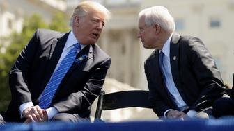 President Donald Trump speaks with Attorney General Jeff Sessions as they attend the National Peace Officers Memorial Service on the West Lawn of the U.S. Capitol in Washington, U.S., May 15, 2017. REUTERS/Kevin Lamarque     TPX IMAGES OF THE DAY