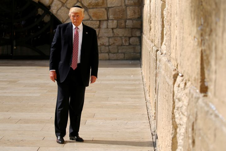 U.S. President Donald Trump stands after leaving a note at the Western Wall in Jerusalem May 22, 2017.