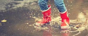 SPLASHING RUBBER BOOT ASPHALT WEATHER CHILD PLAYFUL WALKING FUN STRENGTH JOY RED MESSY WET NATURE OUTDOORS CLOSEUP LEAF AUTUMN WINTER SUMMER