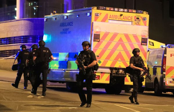 Armed police at Manchester Arena after reports of an explosion at the Manchester Arena during an Ariana Grande concert.