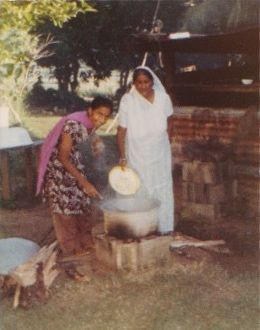 Chahal's great grandmother (father's grandmother) and father's aunt, cooking dinner in Tavua, Fiji.