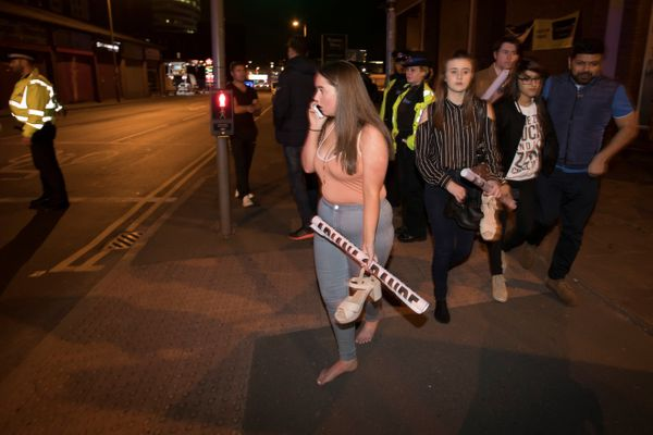 Concert goers react after fleeing the Manchester Arena.