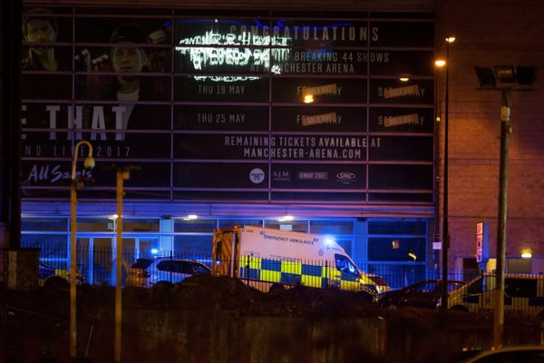 A police van and an ambulance are seen outside the Manchester Arena.