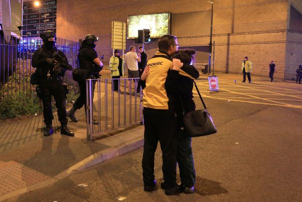 Armed police at Manchester Arena after reports of an explosion at the venue.