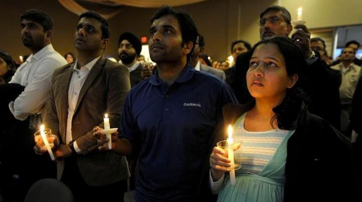 Kuchibhotla's friend, Alok Madasani, survived the shooting. He and his wife Reepthi Gangula in attendance at a vigil for thei