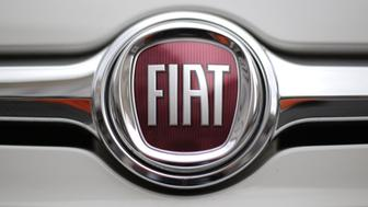 A picture shows the logo of Italian auto maker Fiat in piazza San Carlo on January 22, 2015 in Turin. Fiat-Chrysler said on January 22, 2015 it will add over 1,000 new jobs at its Melfi plant in southern Italy, boosting hopes for the revival of car manufacturers in Europe. The car-maker said the 'extremely positive' results of its new Jeep Renegade and Fiat500X models meant new hires were expected over the next three months.  AFP PHOTO / MARCO BERTORELLO        (Photo credit should read MARCO BERTORELLO/AFP/Getty Images)