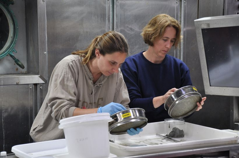 Heyl, left, identifies samples of marine life onboard Alvin, one of the Woods Hole Oceanographic Institute research ships.