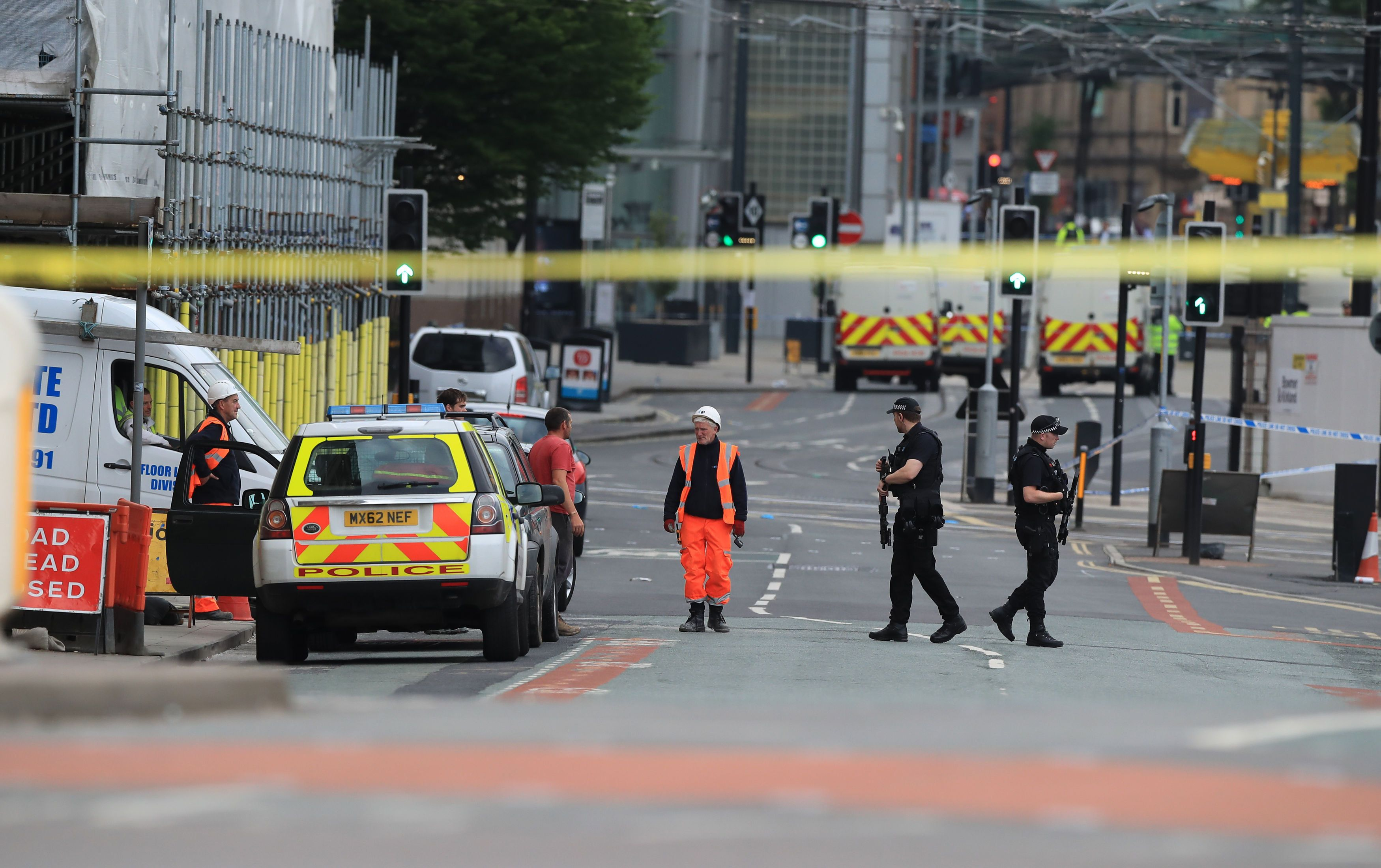 Police remain at the scene on Tuesday morning after a suspected terror attack on the Manchester