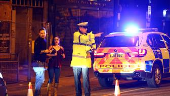 MANCHESTER, ENGLAND - MAY 23: Police stand by a cordoned off street close to the Manchester Arena on May 22, 2017 in Manchester, England.  There have been reports of explosions at Manchester Arena where Ariana Grande had performed this evening.  Greater Manchester Police have confirmed there are fatalities and warned people to stay away from the area. (Photo by Dave Thompson/Getty Images)