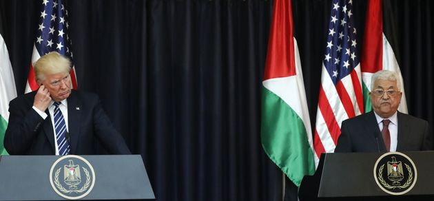 US President Donald Trump (L) and Palestinian leader Mahmud Abbas give a joint press conference at the...