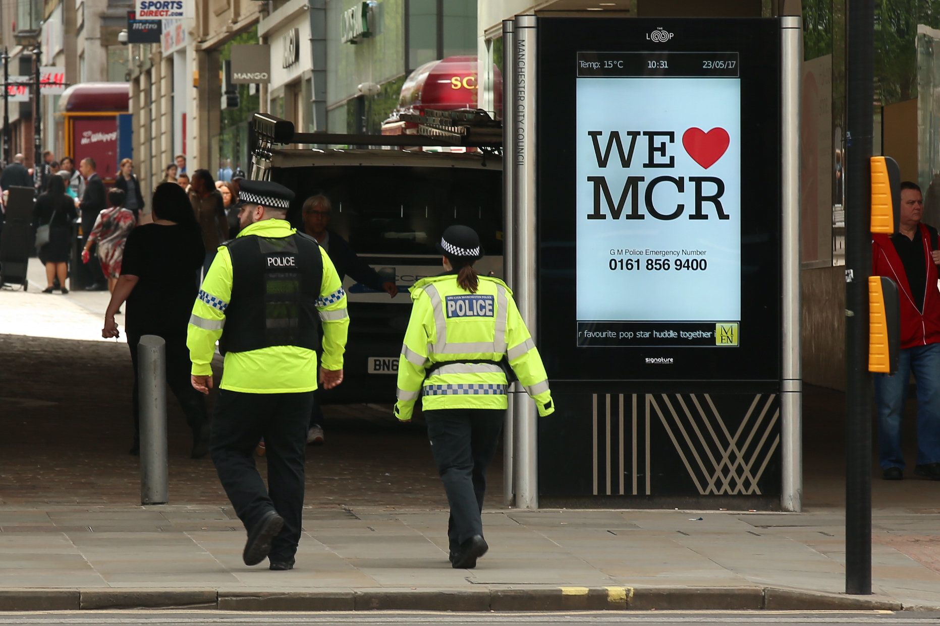 We Love Manchester signs have begun to pop up around the city to show solidarity and to share a helpline...