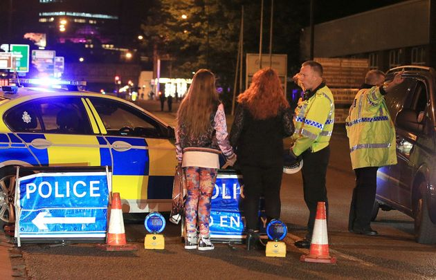Police at the Manchester Arena, where US singer Ariana Grande had just finished performing before the
