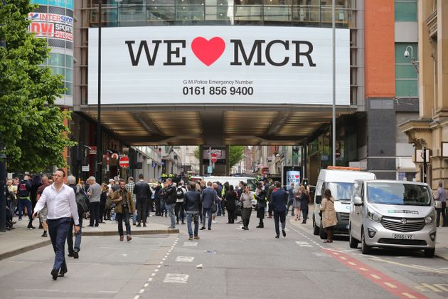'We Love Manchester' signs have sprung up around the