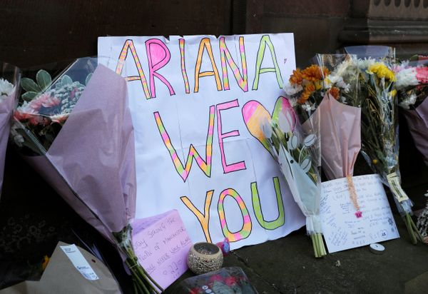 Flowers and messages for the victims of the attack placed in central Manchester.