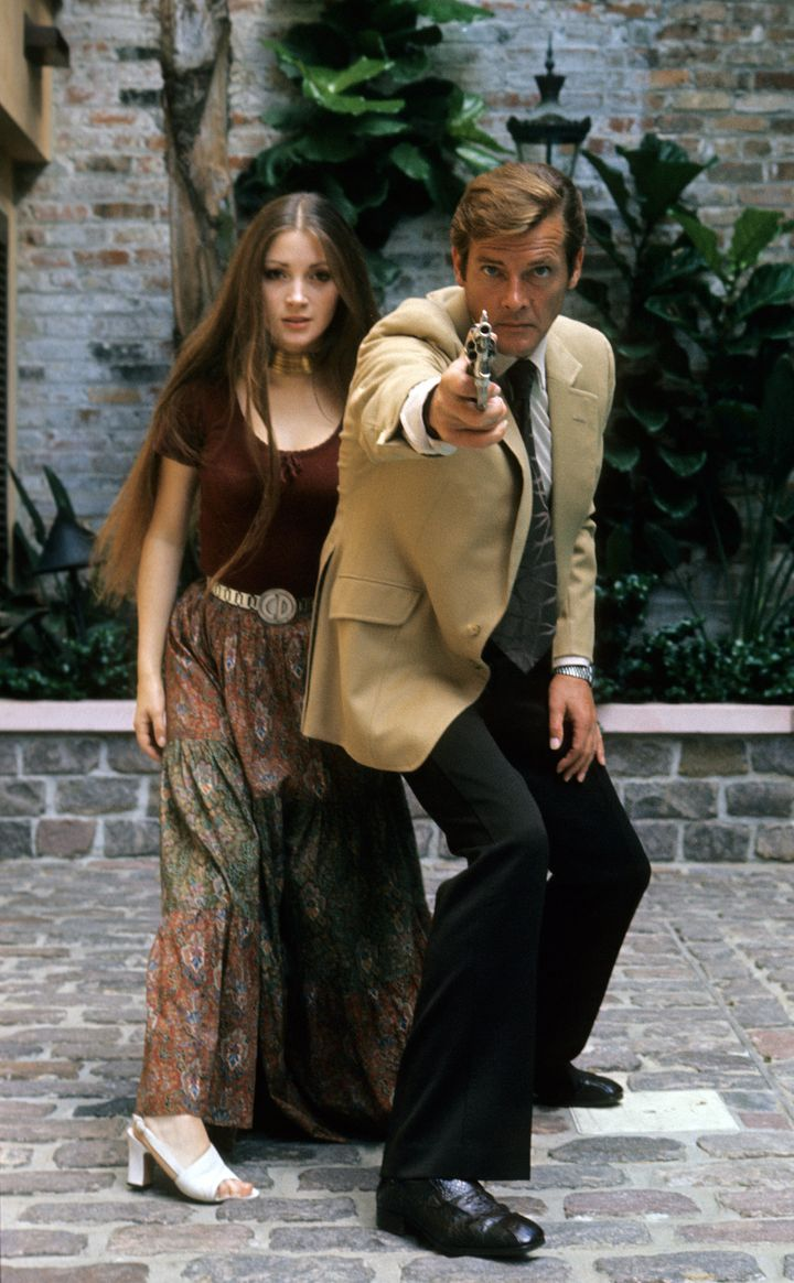 "Jane Seymour and Roger Moore pose during the filming of ""Live and Let Die,"" 1973."