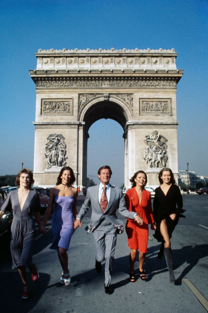 "Roger Moore promoting ""For Your Eyes Only"" in Paris with Bond girls."