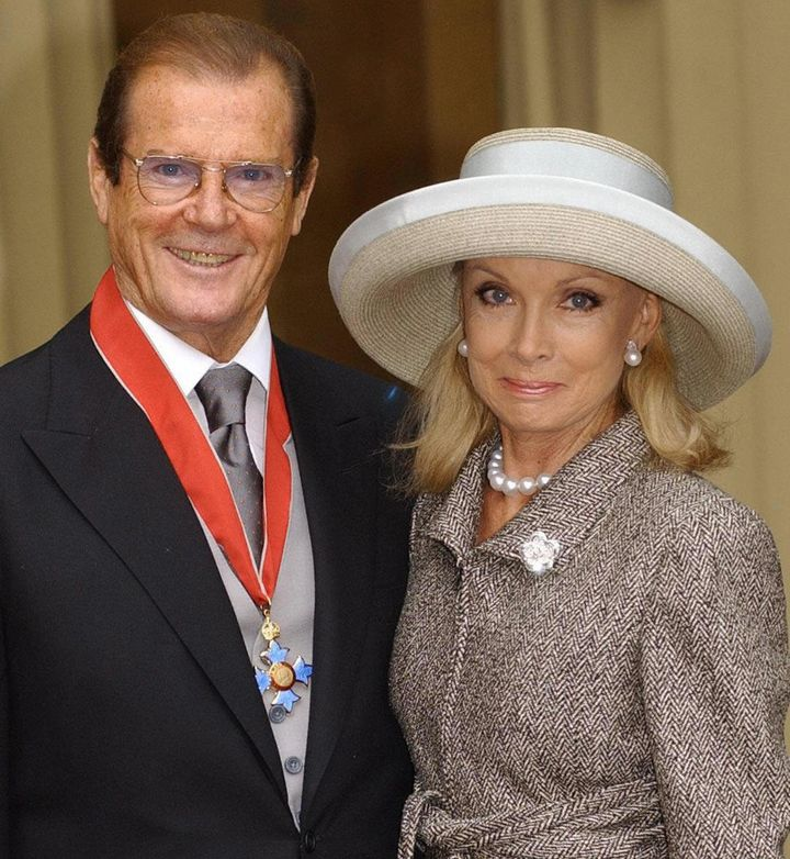 Roger Moore and wife Kristina Tholstrup after Moore received his Knighthood at Buckingham Palace in London, 2003.