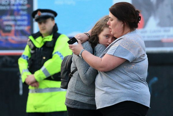 Vikki Baker and her thirteen year old daughter Charlotte hug outside the Manchester Arena.