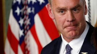 Ryan Zinke pauses after he was sworn in to be Secretary of the Interior in Washington, U.S., March 1, 2017. REUTERS/Joshua Roberts