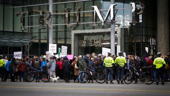 VANCOUVER, March 1, 2017 -- People protest outside the Trump International Hotel and Tower in Canada's Vancouver on Feb. 28, 2017, the building's official opening day. (Xinhua/Liang Sen via Getty Images)
