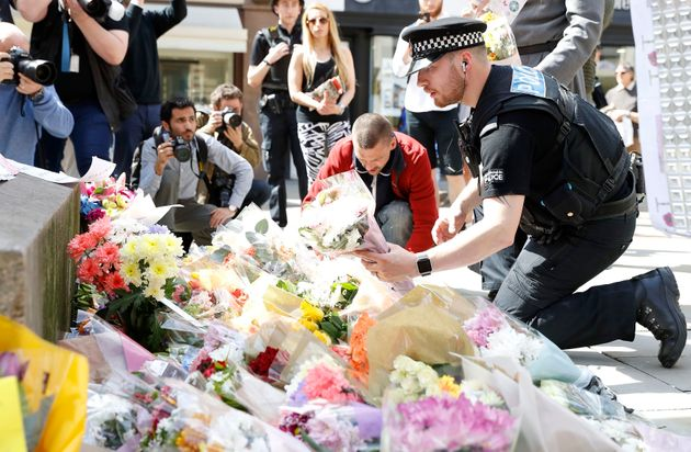 Flowers are being left in St Ann's Square in Manchester, the day after 22 people lost their lives in...