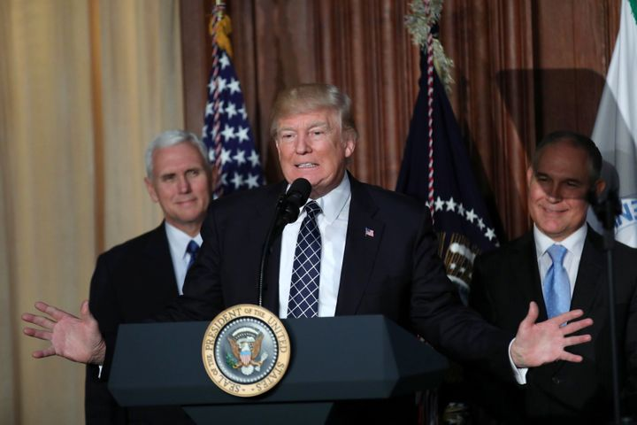 President Donald Trump, flanked byVice President Mike Pence, left, andEnvironmental Protection AgencyAdmini