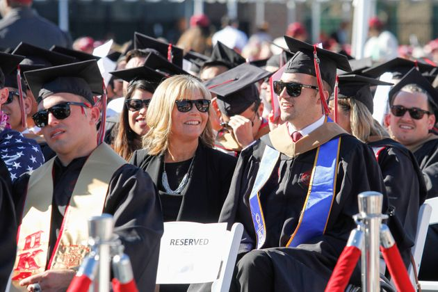 Marty O'Connor, 29, is seen with his mother, Judy O'Connor, during his graduation ceremony...