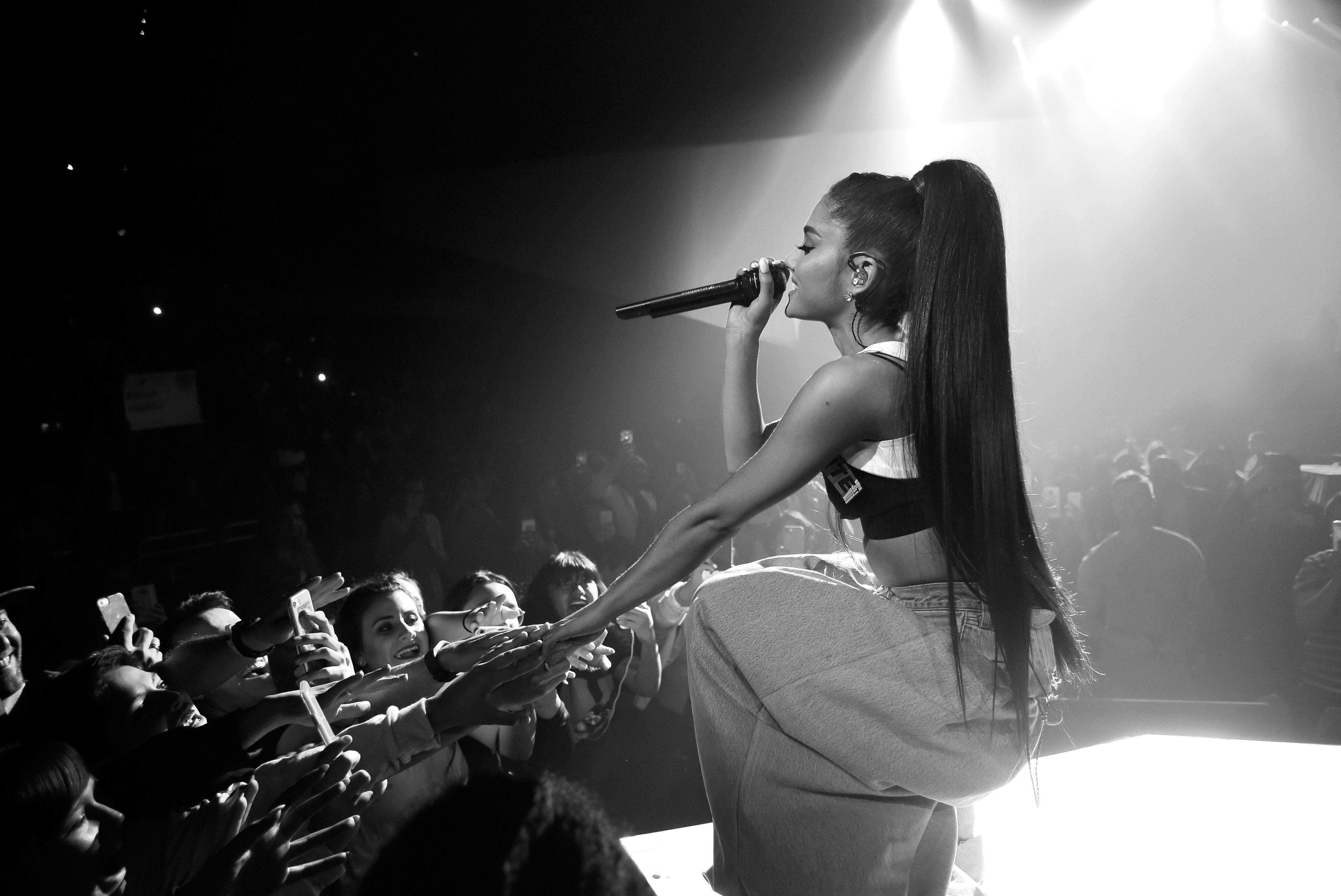 PHOENIX, AZ - FEBRUARY 03:  (EXCLUSIVE COVERAGE) (EDITORS NOTE: This image has been converted to black and white.)  Ariana Grande performs on stage during the 'Dangerous Woman' Tour Opener at Talking Stick Resort Arena on February 3, 2017 in Phoenix, Arizona.  (Photo by Kevin Mazur/Getty Images for Live Nation)