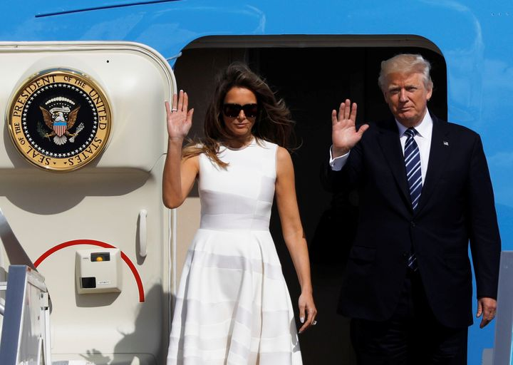 President Donald Trump and first lady Melania Trump wave as they board Air Force One to travel to Rome from Ben Gurion Intern