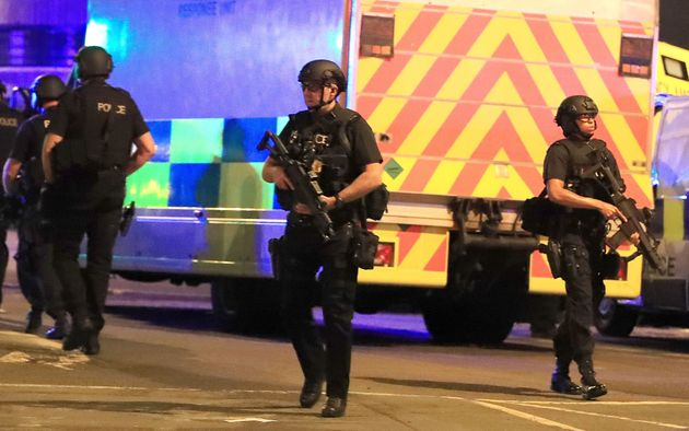 Armed police at Manchester Arena after reports of an explosion at the venue during an Ariana Grande