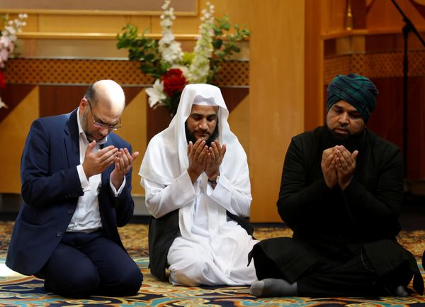 Muslim men pray at a mosque in Manchester for victims of the Manchester Arena attack.