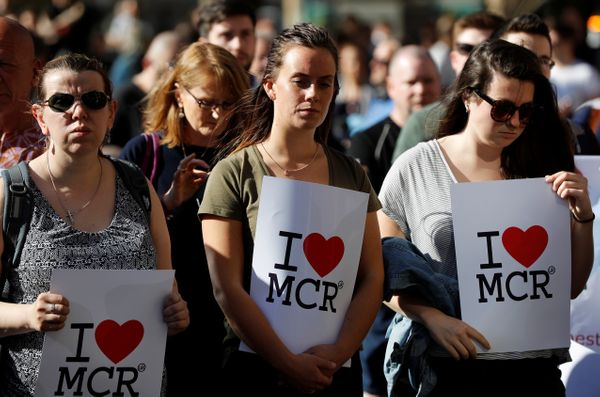 Women wait to take part in a vigil in central Manchester for the victims of an attack on concertgoers at Manchester Arena.