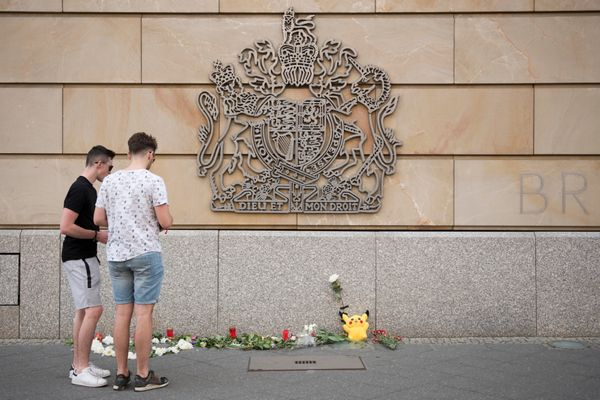 Flowers and candles lay in front of British Embassy in Berlin the day after the attack at Manchester Arena.
